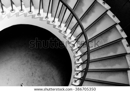 Spiral stairway detail. Historic building architectural element. Black and White photo. - stock photo