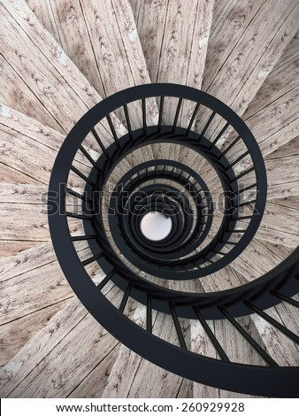 Spiral wood stairs with black painted balustrade - stock photo