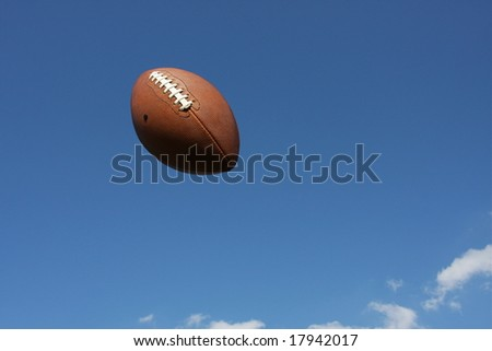 Spiraling football in the sky - stock photo