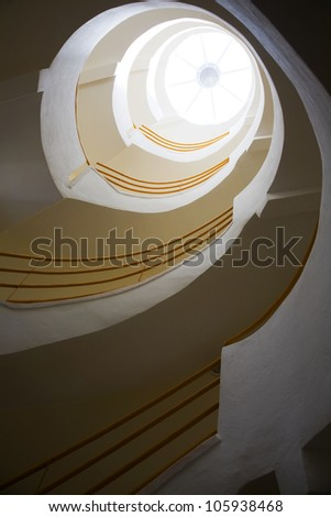 Spiraling stairs and skylight - stock photo