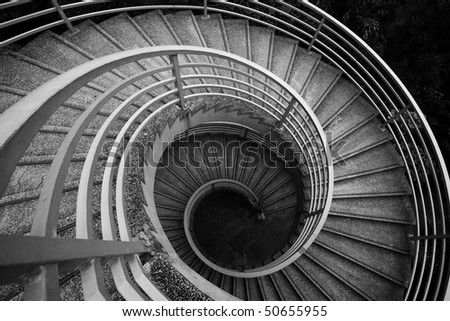 spiraling stairs, black and white - stock photo