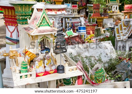 Spirit House Thailand that were damaged were left at the side of the road.