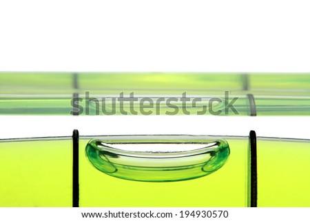 Spirit level , extreme macro image, on white background. - stock photo