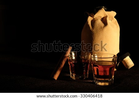Spirit Liquor with Cigar and Bottle with Copy Space on Left - stock photo