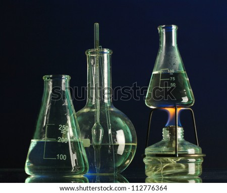 spiritlamp and test-tubes on blue background
