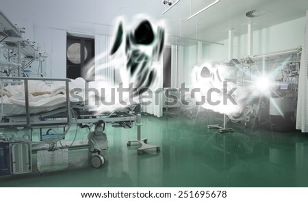 Spirits flying above the critically ill patients. Concept of struggle between life and death - stock photo