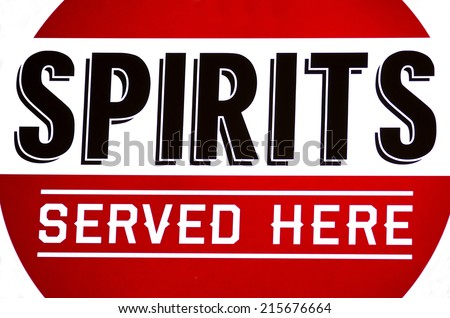 Spirits served here sign in a bar window - stock photo