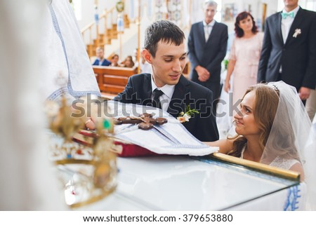 Spiritual beautiful bride and groom taking vows in church at Bible