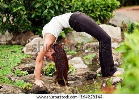 "Spiritual fit woman doing yoga pose ""Bridge"" - stock photo"