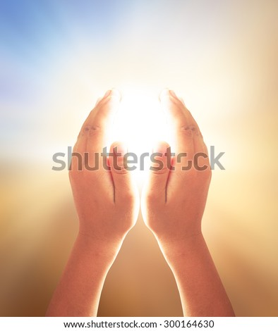 Spiritual hands over blurred beautiful sunset background. Human hands of pay obeisance over nature background. Responsibility, Thanksgiving, Christmas, Health Care, Forgiveness, Repentance  concept. - stock photo