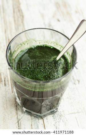 Spirulina algae drink isolated on white - stock photo