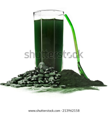 Spirulina algae powder glass drink nutritional supplement close up , isolated on white background - stock photo