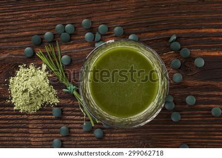 Spirulina, chlorella, barley and wheatgrass. Green supplement, superfood detox. - stock photo