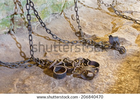 SPISSKY CASTLE, SLOVAKIA - JULY 19, 2014: The irons from oubliette the castle. - stock photo
