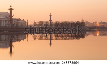 Spit of Vasilievsky Island and Rostral Columns in St. Petersburg, Russia - stock photo