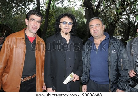 "SPITAK, ARMENIA - OCTOBER 1: Tony Iommi of Black Sabbath and his fans on October 1, 2009 in Spitak, Armenia. He visits Armenia within the framework of ""Armenia Grateful 2 Rock"" project."