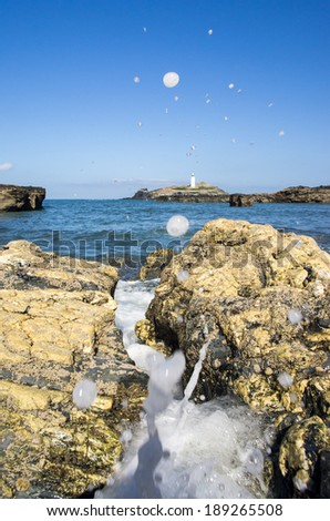 splash at godrevy cornwall - stock photo