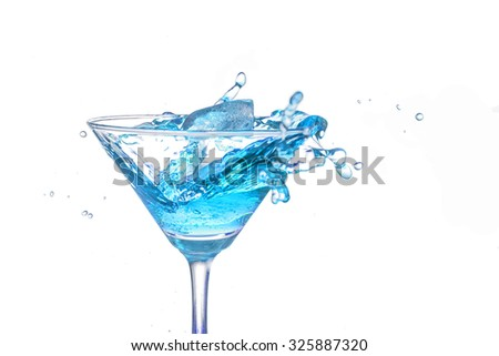 Splash cocktail in a martini glass on white background - stock photo