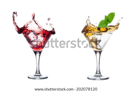 Splash from mint in a glass of cocktail, isolated on the white background. - stock photo
