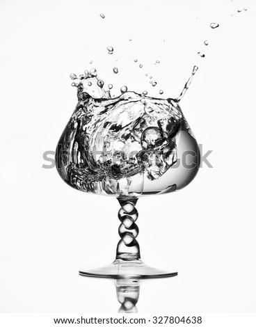 Splash in a glass of water on white background - stock photo
