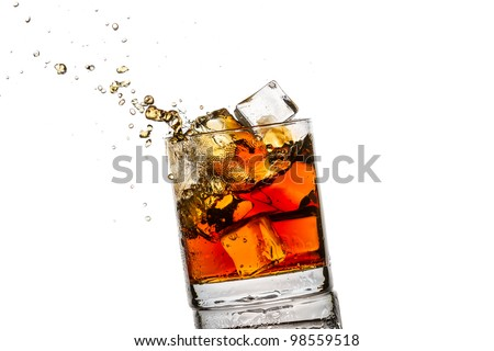 Splash in glass with whisky and ice cubes on white background - stock photo