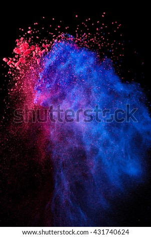 Splash of crushed eye shadow on black background - stock photo