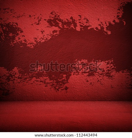 splash of paint on the red wall - stock photo