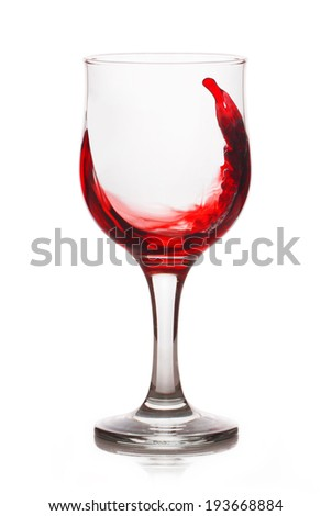 Splash of red wine in a glass - stock photo