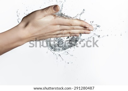 Splash of Water in Woman Hand