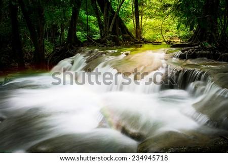 Splash of Waterfall with rainbows - stock photo
