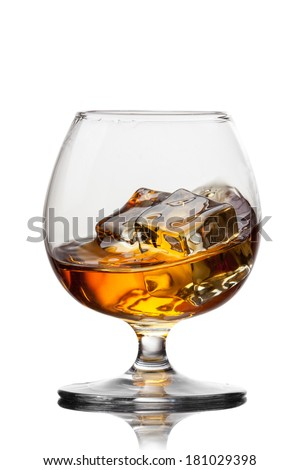 Splash of whiskey with ice in glass isolated on white background - stock photo