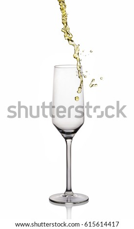 Splash of white wine in glass with reflection isolated on white background