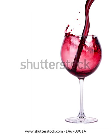 Splash red wine  against a white background - stock photo