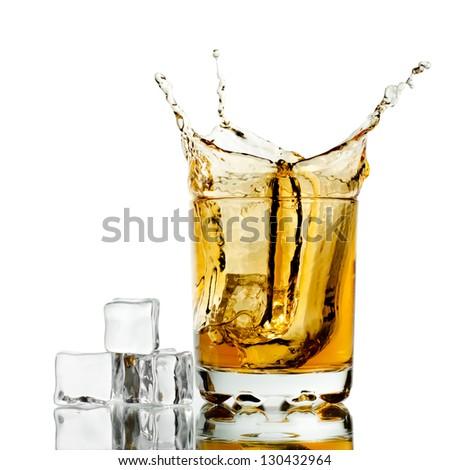 Splashed whisky with ice cubes - stock photo