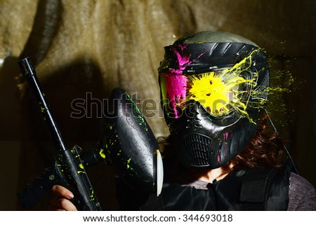 Splashes after direct hit to protecting mask in the paintball game  - stock photo