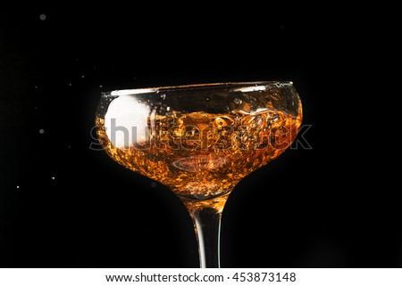 splashes of champagne in a glass
