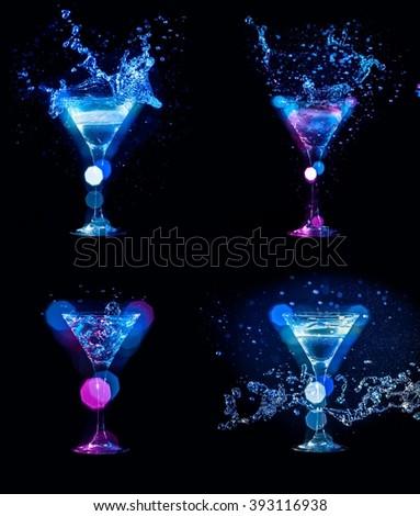 splashes of cocktails in glasses set on black background - stock photo