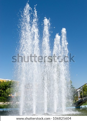 Splashes of fountain water in a sunny day - stock photo
