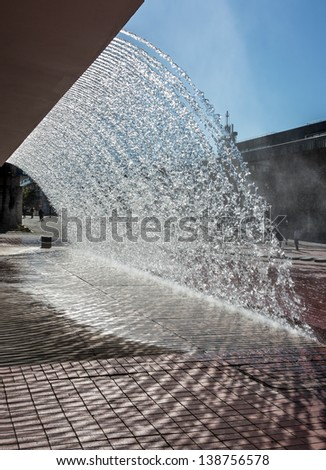 Splashes of fountain water in a sunny day near the oceanarium in Lisbon - Portugal - stock photo