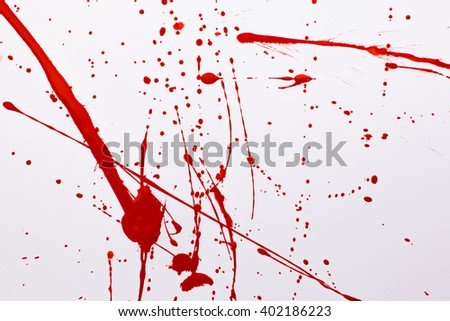 splashes of red paint on a white background