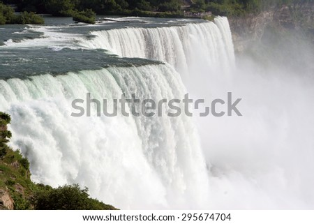 Splashes of the Niagara falls in a summer day