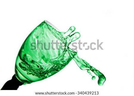 Splashing  absinthe liqueur in the glass.