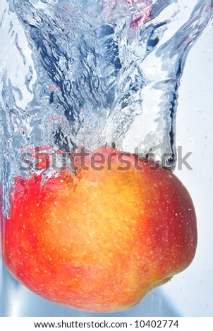 splashing apple into a water - stock photo