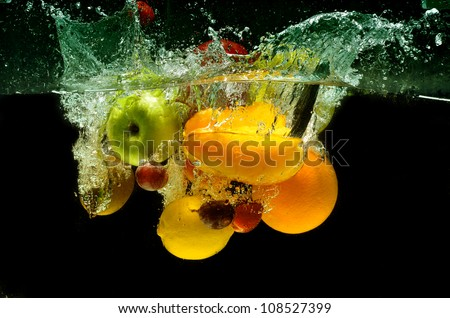Splashing fruit on water. Fresh Fruit and Vegetables being  shot as they submerged under water.  Illustration of Washing food before being process further into a healthy and natural food