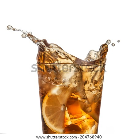 splashing iced tea with lemon isolated on a white background - stock photo