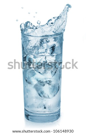 Splashing of water with ice in glass, isolated on white - stock photo