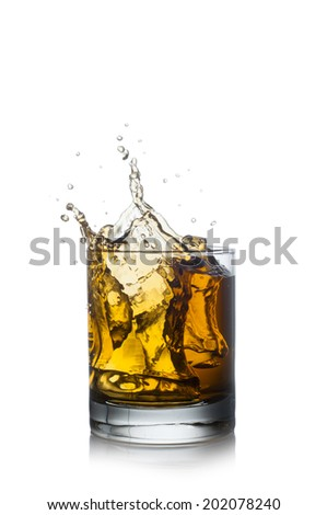 Splashing of whiskey out of glass isolated on white
