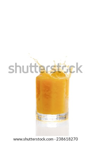 Splashing orange juice against white background
