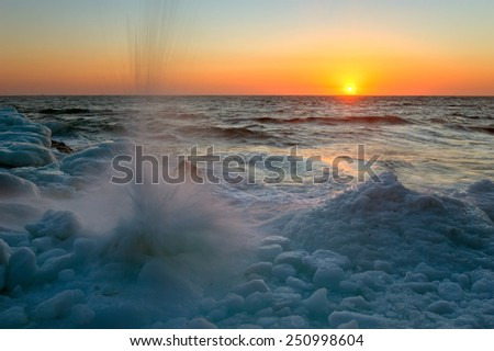Splashing waves of the sea ice. - stock photo