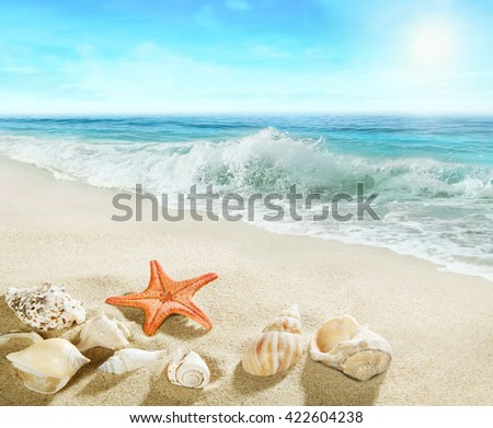 Splashing waves on the beach. - stock photo